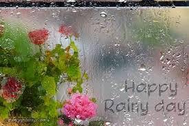 happy rainy day written on wet mirror