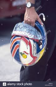 Tony Kanaan s helmet half painted in Alex Zanardi s colors in ...