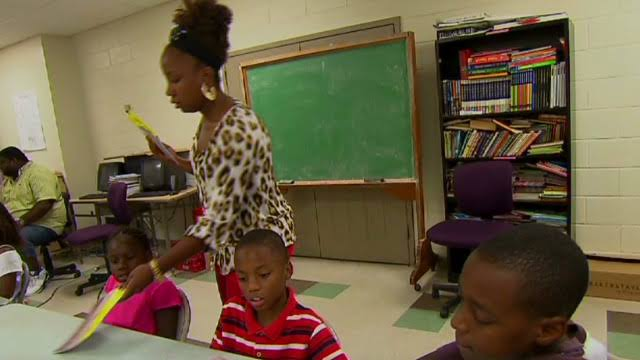 Image result for black woman teaching kids