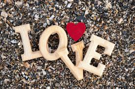 word love with a red heart beach sand