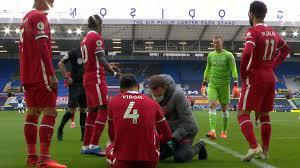 Virgil van Dijk injured by Pickford ...