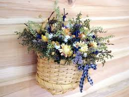 wall basket filled with dried flowers