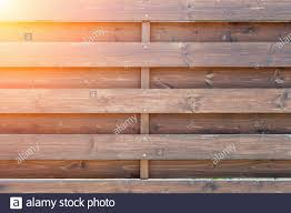 Old Wooden Texture Painted With Varnish Fence Or A Fence Of Horizontal Planks Parallel Slats Of Solid Pine At Intervals Copy Space Stock Photo Alamy