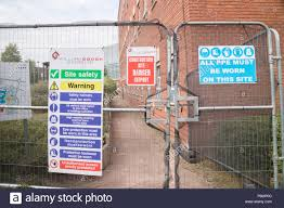 Health And Safety Signage And Security Fencing On A Construction Site England Uk Stock Photo Alamy