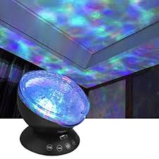Amazon Com Wave Night Light Projector With Music Player Led Color Changing Projection Lamp Relaxing Sleep Soother Mood Lighting For Living Room Bedroom Gift For Teens Kids Birthday Christmas Musical Instruments