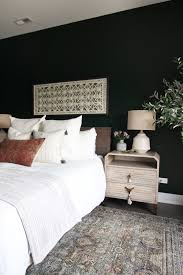 dark green guest room with boho style