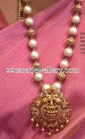 pearl necklace with laxmi pendant
