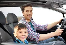 child sit in the front seat of car