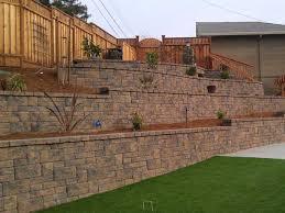 retaining wall tames slope creates