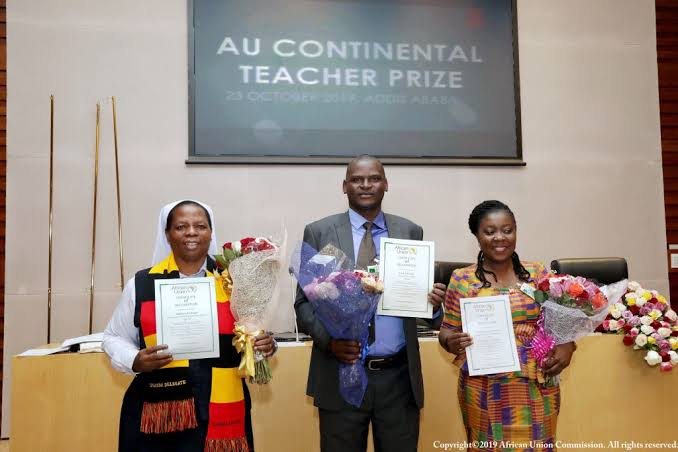 Mr. Eric Ademba, Centre, winner of the 2019 edition of the African Union Continental Teacher Award.