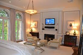flat screen tv and fireplace in
