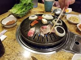 cooking on the korean bbq at our table