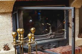 how to clean fireplace glass properly
