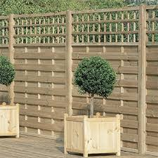 decorative fence panels frame a garden