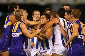 AAron Edwards and Adam Selwood scuffle at Docklands. - ABC News (Australian  Broadcasting Corporation)