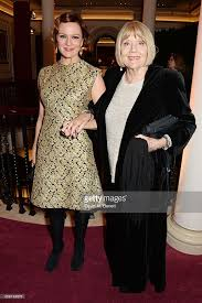 Rachael Stirling and Dame Diana Rigg attend a champagne reception at...