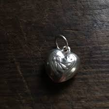 small heart shaped pendant in silver