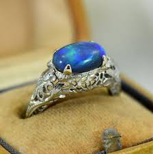 art deco filigree ring with peacock