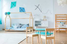 Small Table With Wooden Chair In Kids Bedroom With Wooden Bed Stock Photo Picture And Royalty Free Image Image 85531935