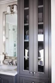 black linen cabinets with glass doors