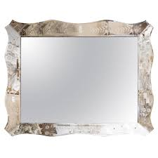 grand scale venetian wall mirror in