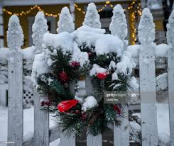 Pine Needle Holiday Wreath In The Snow On A White Picket Fence High Res Stock Photo Getty Images