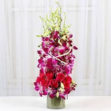 roses and orchids vase arrangement