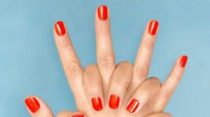 woman posts dip powder manicure