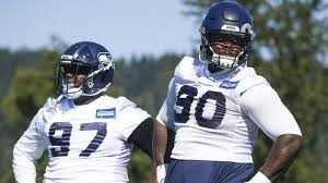 Seahawks DTs Poona Ford, Jarran Reed suffer apparent injuries on Friday
