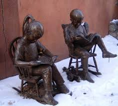 cute bronze statues of a young boy and