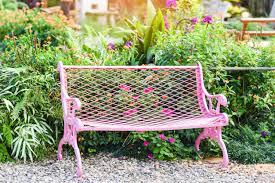 pink vintage bench chair in the garden