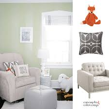 a modern nursery with sage green paint