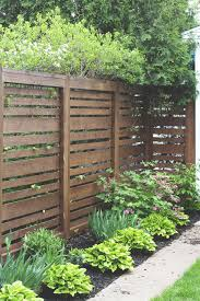 1 Year Later Our Horizontal Fence Fence Landscaping Privacy Fence Designs Backyard Fences
