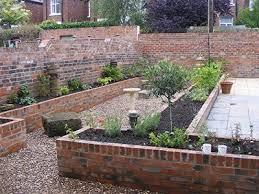 long raised beds built of brick