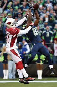 Patrick Peterson #21 of the Arizona Cardinals breaks up a pass intended for Kevin  Norwood #81