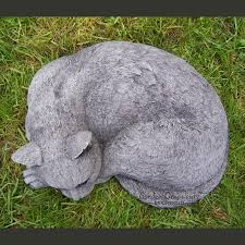 curled up cat stone garden ornament