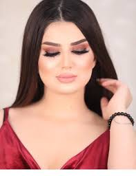 cool makeup and red dress