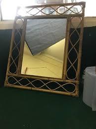 bent bamboo framed wall mirror
