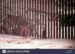 Children Slipping Through The Fence At The International Border At Stock Photo Alamy