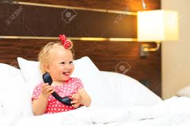 Cute Little Girl Taking On The Phone In Hotel Room Kids Travel Stock Photo Picture And Royalty Free Image Image 45128062