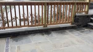 blue stone patio with cedar railing