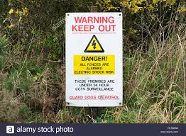 Electric Fence And Guard Dog Dangerous Building Construction Site Keep Out Health And Safety Signs Stock Photo Alamy