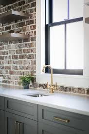 pantry cabinets with exposed brick wall