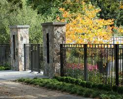 Lovely Wrought Iron Fence Front Yard With Stone Pillars Jpg 700 560 Pixels Fence Gate Design Iron Fence Front Yard Fence
