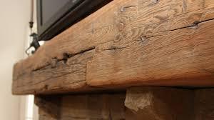 reclaimed wood beams rustic fireplace