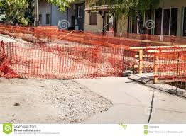 Construction Site Orange Safety Net Fence As Barrier Over The Trench On The Street Excavation For New District Heating Pipeline Re Stock Image Image Of Heat Excavation 115516419