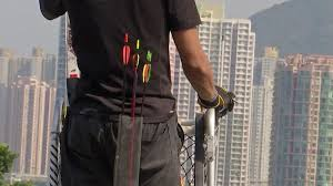 hong kong protesters wielding bows and