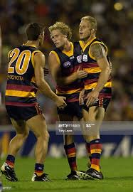 Adam Richardson for Adelaide is congratulated by Kane Johnson and... News  Photo - Getty Images