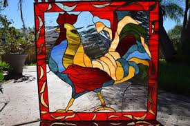 colorful rooster stained glass window