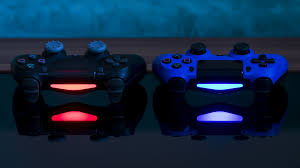 black and blue sony ps4 game controller